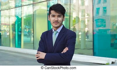 Asian businessman stading and looking in camera