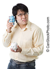Asian businessman with piggy banks