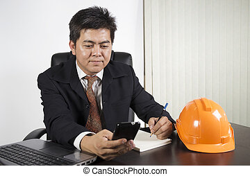 Asian businessman working on the desk