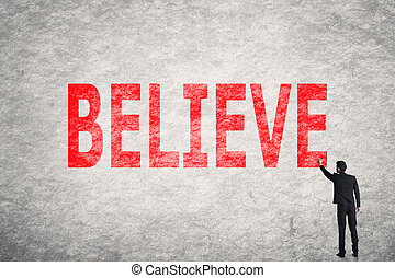 text on wall, Believe