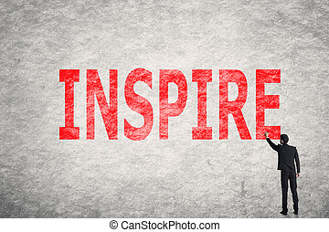 text on wall, Inspire - Asian businessman write text on...