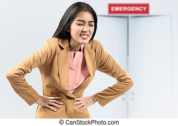 Asian businesswoman feeling stomach ache on the emergency room