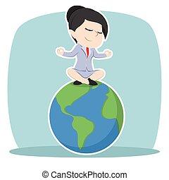 Asian businesswoman meditating on earth