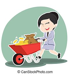 Asian businesswoman pushing wheelbarrow full of coins