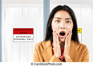 Asian businesswoman shocked in front of the quarantine room