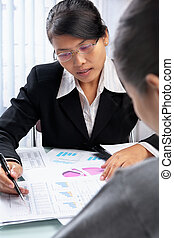 Asian businesswoman showing data