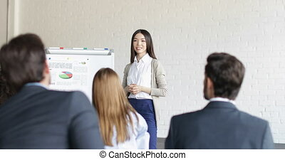 Asian Businesswoman Speaker On Presentation With Group Of...
