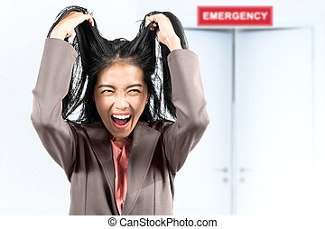 Asian businesswoman stress in front of the emergency room