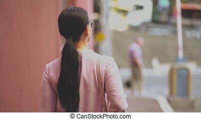 Asian businesswoman walking on street smiling - Slim Office...
