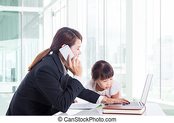 Asian businesswoman with her daughter at office