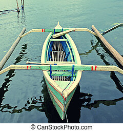 Asian canoe on the lake