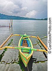 Asian canoe on the lake