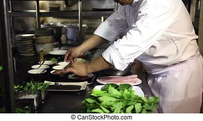 Asian chef cooking and smiling - Portrait of adult man at ...