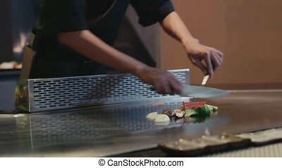 Asian chef cooking food, kitchen