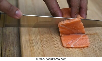 Asian chef slice japanese food sashimi salmon - Asian chef...