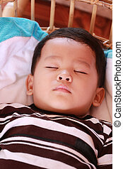 Asian child boys about two years old Sleeping in bed. -...