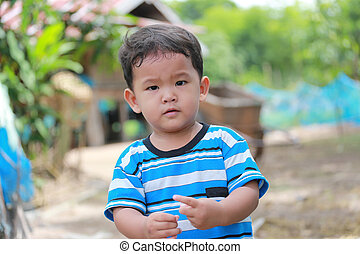 Asian child boys in happy emotion about two years old. -...