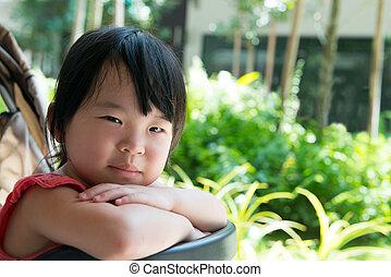 Asian child girl in stroller