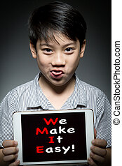 Asian child holding digital tablet ,With  WE MAKE IT EASY!