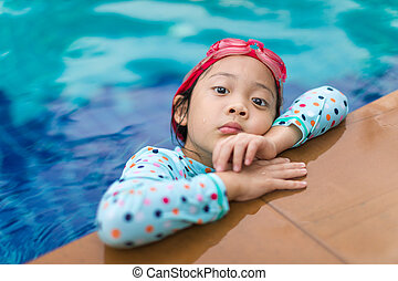 Asian Child in Swimming Pool