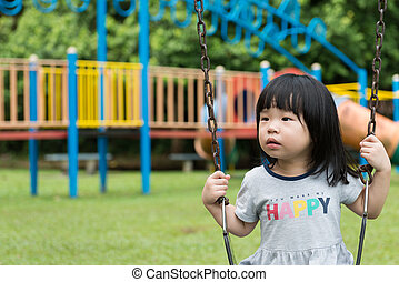 Asian child on swing