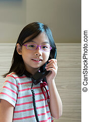 Asian child talking on the phone