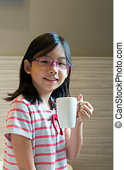 Asian child with a mug