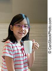 Asian child with a mug