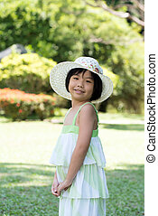 Asian child with summer hat