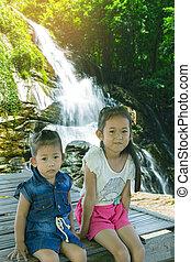 Asian children girl at Tad Mork Waterfall in Maerim Chiang Mai Thailand
