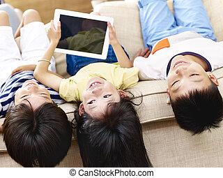 asian children having fun at home