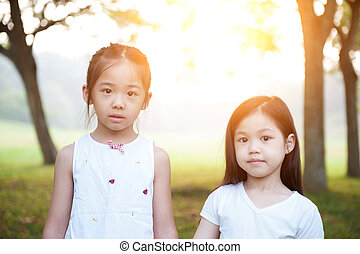 Asian children outdoor portrait.