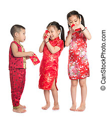 Asian children peeking into red packet during Chinese New ...