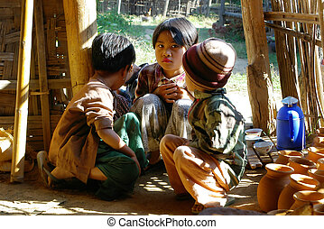 asian children in wooden house