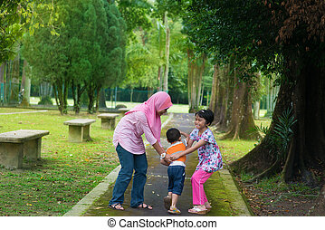 Asian children playing at outdoor