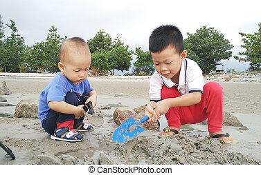 Asian children playing sand