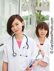 asian chinese doctors team at the hospital