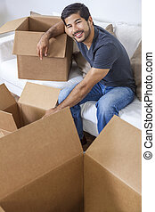 Asian Chinese Korean Man Unpacking Boxes Moving House
