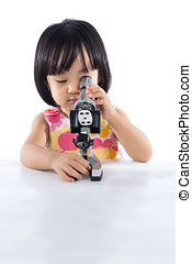 Asian Chinese little girl with microscope