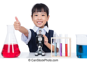 Asian Chinese little girl working with microscope