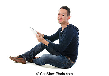 asian chinese  man with a tablet in casual