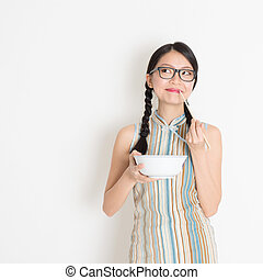Asian Chinese woman eating - Portrait of Asian Chinese woman...