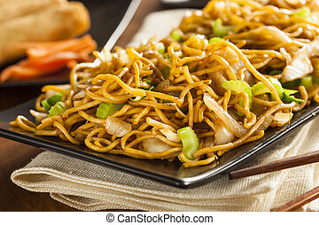 Asian Chow Mein Noodles with Vegetables and Chopsticks