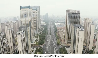 Asian city aerial - Highway road cross skyscrappers building...