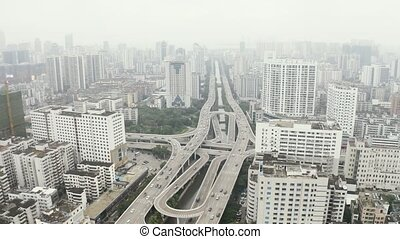 Asian city aerial - Highway road intersection in asian city,...