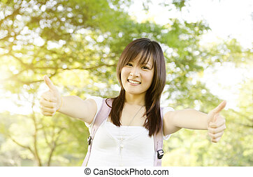 Asian college girl student thumb up
