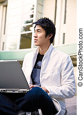 Asian college student and laptop