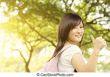 Asian college student thumb up
