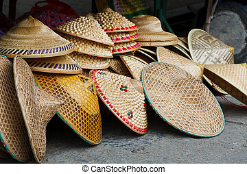 Asian conical hats traditionally worn by rice farmers