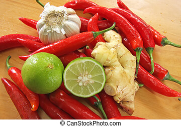 Asian cooking ingredients - Red chillis, garlic, ginger and...